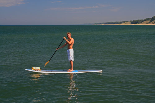 standup paddle boarding in lake michigan by holland